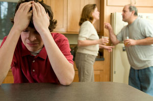 bigstockphoto_Parents_Fight_Son_Suffers_300X199